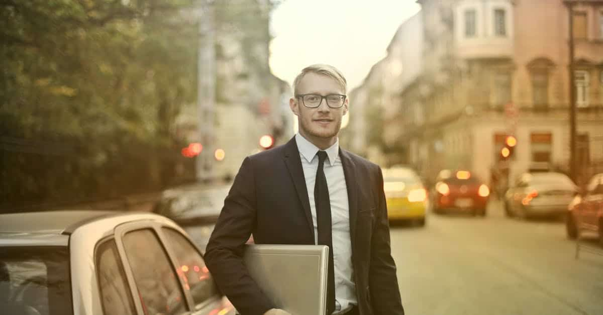 A person wearing a suit and tie walking down the street